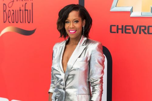 Great Outfits in Fashion History: Regina King's Metallic Suit and Bold Pink Lip