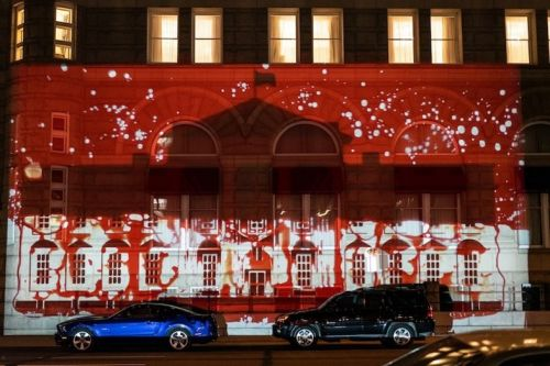 Artists project White House filled with human blood on a Trump hotel