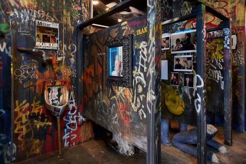 'Meet Me In the Bathroom' exhibit is more than a filthy, graffiti'd stall