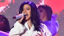 Cardi B Hits The Stage In A Bathrobe Following Bonnaroo Wardrobe Malfunction