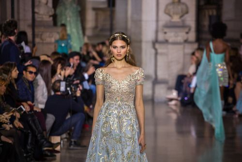 Light blue silk tulle gown embroidered with golden threads