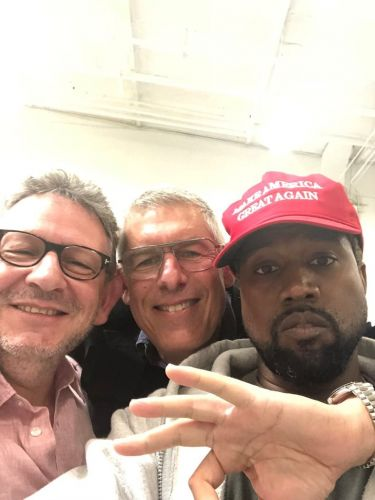 "Kanye West wears MAGA hat, says Trump has ""dragon energy"""