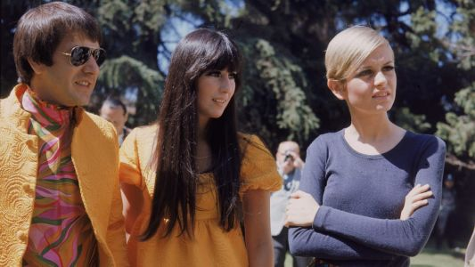 Great Outfits in Fashion History: Sonny and Cher in Coordinating Saffron Looks
