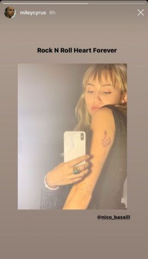 What Does Miley Cyrus' New Tattoo Say About Her Relationship With Cody Simpson?
