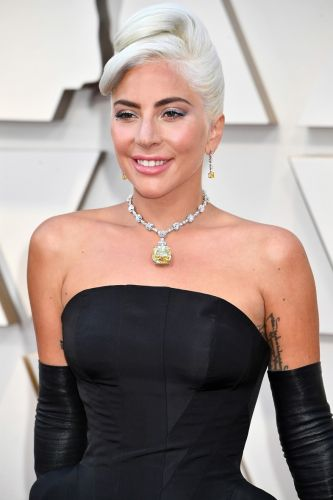 The Story Behind Lady Gaga's 128-Carat Yellow Diamond Oscars Necklace
