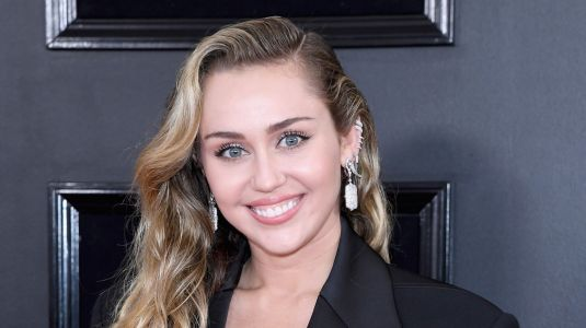 Work It, Girl! Miley Cyrus Kills It in a Black Pantsuit at the Grammys