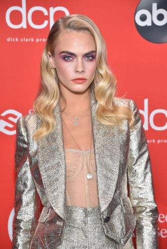 Cara Delevingne Says She Stopped Herself From Getting a Boob Job
