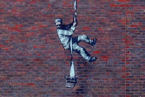 Possible New Artwork from Banksy Appears on Reading Prison Wall