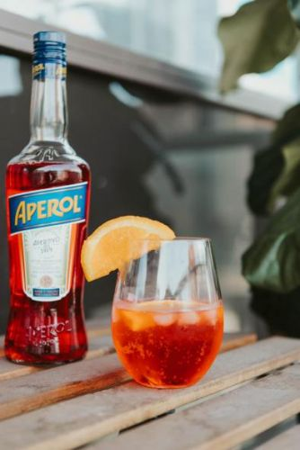 "Add A Little ""Dolce Vita"" To Your Dinner - Try Tribe's CBD Aperol Spritz Recipe"