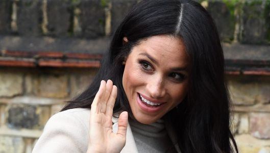 Meghan Markle Looks Radiant Showing Off Her Baby Bump In A Classy Beige And Gray Outfit