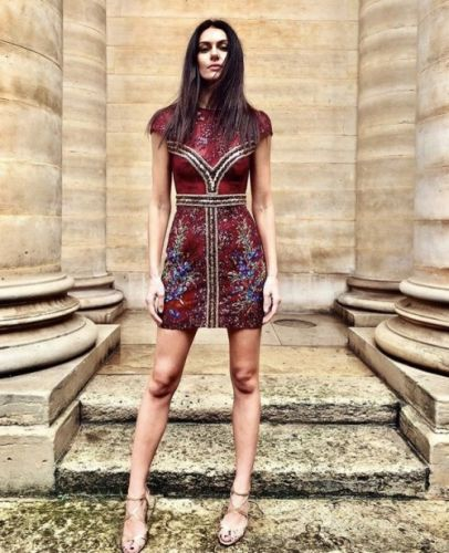 A radiant Paola Turani taking over the streets of Paris in