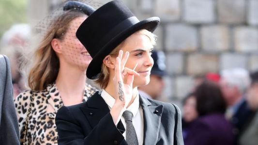 Cara Delevingne Attends Princess Eugenie's Wedding Wearing a Top Hat and Tuxedo