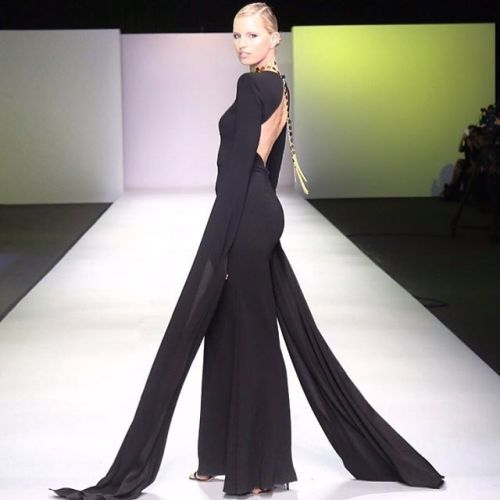 Loving the long dramatic sleeves and backless alexperryofficial